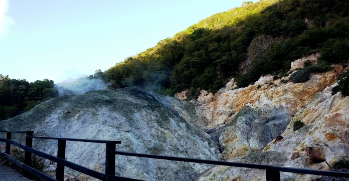 The volcano has a safety barrier to help prevent accidents.  Notice the smoke as it rises.